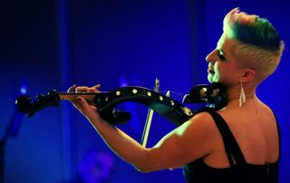 Viola Player Eliza is available to hire from Atrium Entertainment Agency